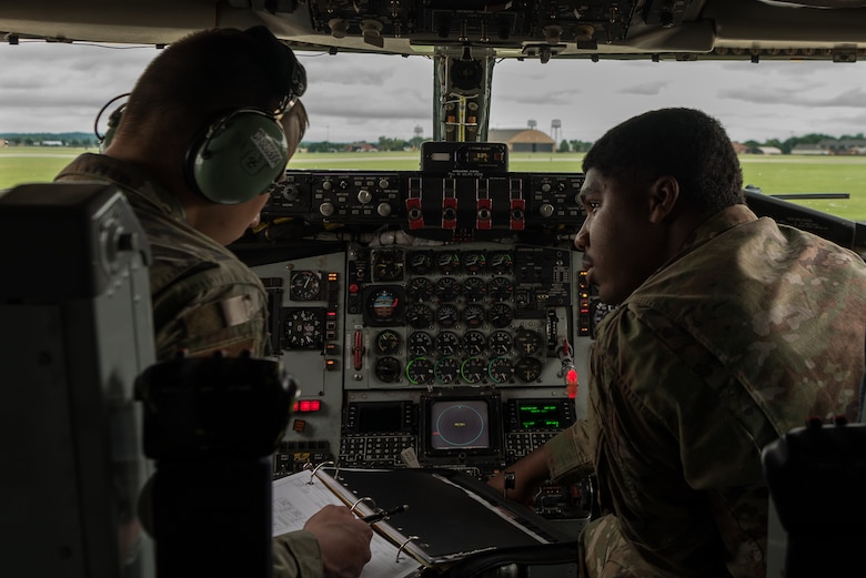 U.S. Air Force Senior Airman Sabian Scott, 906th Air Refueling Squadron KC-135 Stratotanker aerospace maintenance journeyman, and U.S. Air National Guard Airman 1st Class Brian Okoniewski 126th ARS  KC-135 aerospace maintenance journeyman, inspect the refueling panel inside of a KC-135 on Scott Air Force Base, Illinois, June 2, 2021. The refueling panel allows them to inform the Airmen outside of the aircraft when the aircraft is refueled. (U.S. Air Force photo by Airman 1st Class Mark Sulaica