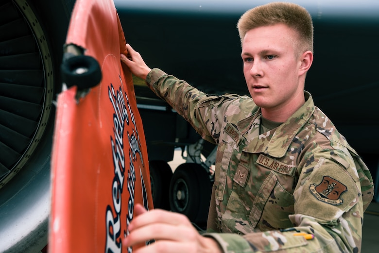 U.S. Air National Guard Airman 1st Class Paul Kampwerth, 126th Air Refueling Squadron hydraulics apprentice, equips an engine cover on a KC-135 Stratotanker on Scott Air Force Base, Illinois, June 2, 2021. Kampwerth was putting on the engine cover to prevent debris from interfering with the aircraft engines while routine maintenance was performed. (U.S. Air Force photo by Airman 1st Class Mark Sulaica)
