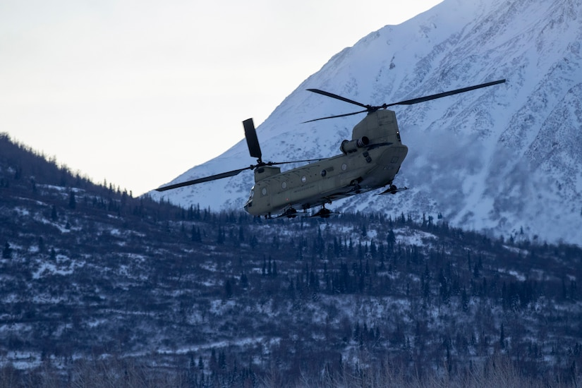 An Alaska Army National Guard Ch-47 Chinook helicopter departs Bryant Army Airfield Dec. 11, 2020
