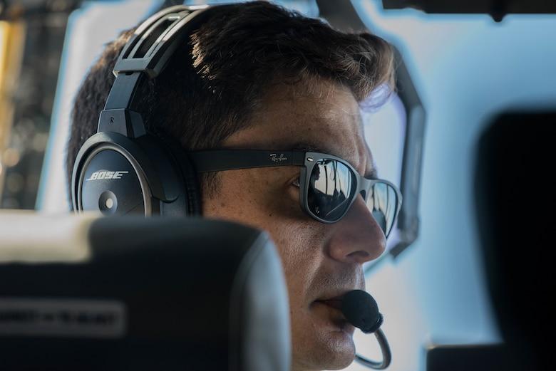 Airman pilot looks out window