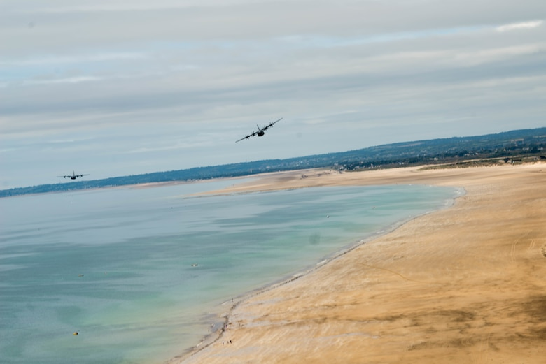 Planes fly over Normandy Beach