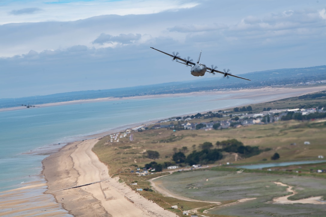 C-130J Super Hercules aircraft assigned to Ramstein Air Base, Germany, fly over the beaches of Normandy June 6, 2021.