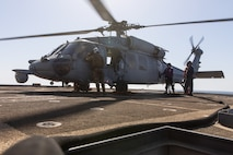 210602-A-UN662-1776 ARABIAN GULF (June 2, 2021) – An MH-60S Sea Hawk helicopter, attached to Helicopter Sea Combat Squadron (HSC) 26, refuels on the flight deck of guided-missile cruiser USS Monterey (CG 61) in the Arabian Gulf, June 2. HSC-26 is deployed to the U.S. 5th Fleet area of operations in support of naval operations to ensure maritime stability and security in the Central Region, connecting the Mediterranean and Pacific through the western Indian Ocean and three critical chokepoints to the free flow of global commerce. (U.S. Army photo by Sgt. Wheeler Brunschmid)