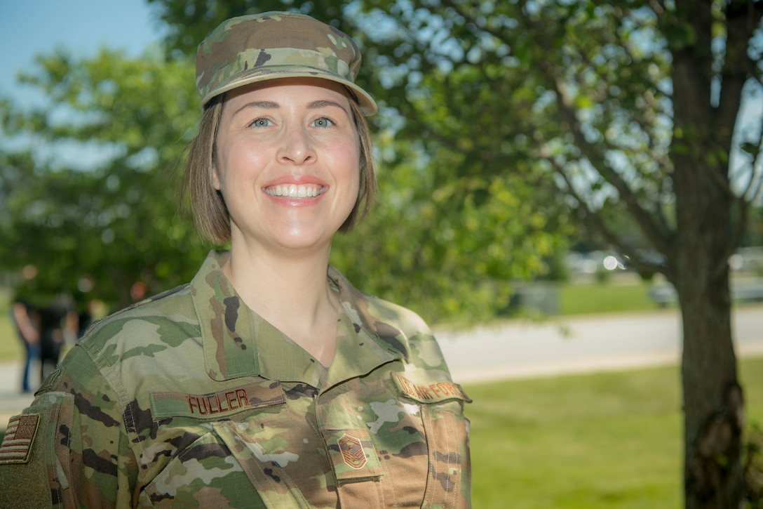 Senior Master Sgt. Shannon Fuller, Civil Engineering first sergeant, poses for a portrait outside of the 434th Air Refueling Wing headquarters, June 5, 2021, Grissom Air Reserve Base, Indiana. Fuller recently graduated from Ivy Tech Community College of Indiana and was the honoree of the Chancellor Award. (U.S. Air Force photo by SSgt. Alexa Culbert)