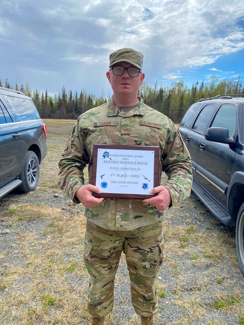 Alaska Air National Guard Staff Sgt. Matthew Larson, a security forces member with the 268th Security Forces Squadron, poses for a photo after the annual Adjutant General Match, May 16, 2021. Larson took first place in the open rifle marksmanship competition, was added to the state team to compete in the regional competition, and was awarded the Governor's Twenty tab, which is generally awarded to the top 20 marksmen in the state.