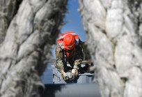 A U.S. Soldier from the 7th Transportation Brigade (Expeditionary) secures a shipping crate aboard a barge at 3rd Port, Joint Base Langley-Eustis, Virginia, March 9, 2021. The supplies and equipment were loaded within a few days time and transported to an exercise. (U.S. Air Force photo by Senior Airman Sarah Dowe)
