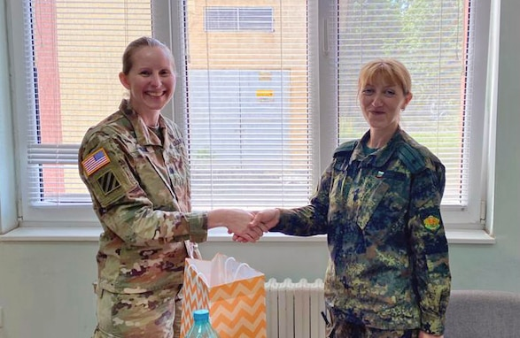 U.S. Army Reserve Lt. Col. Mary J. Durham, commander of the 773rd Civil Support Team, 7th Mission Support Command, left, shakes hands with Bulgarian Army Maj. Natalya Ivanova, commander of the 38th Chemical, Biological, Radiological, Nuclear Defence Battalion during a military-to-military exchange held in Sofia, Bulgaria, May 25-28, 2021. The event was designed to enhance relationships and interoperability with Allies and partner nations. (U.S. Army Reserve photo by Staff Sgt. Rosannie Murillo, 773rd CST)