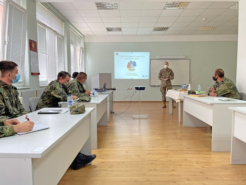 U.S. Army Reserve Lt. Col. Mary J. Durham, commander of the 773rd Civil Support Team, 7th Mission Support Command, briefs chemical, biological, radiological, nuclear reaction capabilities to Soldiers from the Bulgarian Army's 38th CBRN Defence Battalion during a military-to-military exchange held in Sofia, Bulgaria, May 25-28, 2021. The event was designed to enhance relationships and interoperability with Allies and partner nations. (U.S. Army Reserve photo by Staff Sgt. Rosannie Murillo, 773rd CST)