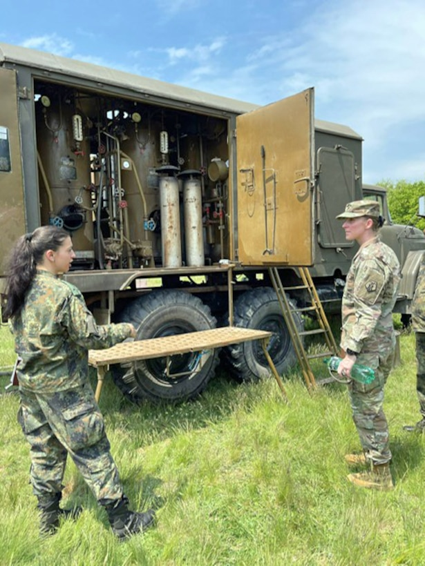 U.S. Army Reserve Lt. Col. Mary J. Durham, commander of the 773rd Civil Support Team, 7th Mission Support Command, right, receives a brief from Bulgarian Army 1st Lt. Polina Dimova, a chemical, biological, radiological, nuclear platoon commander with the 38th CBRN Defence Battalion, during a military-to-military exchange held in Sofia, Bulgaria, May 25-28, 2021. The event was designed to enhance relationships and interoperability with Allies and partner nations. (U.S. Army Reserve photo by Staff Sgt. Christopher Branning, 773rd CST)