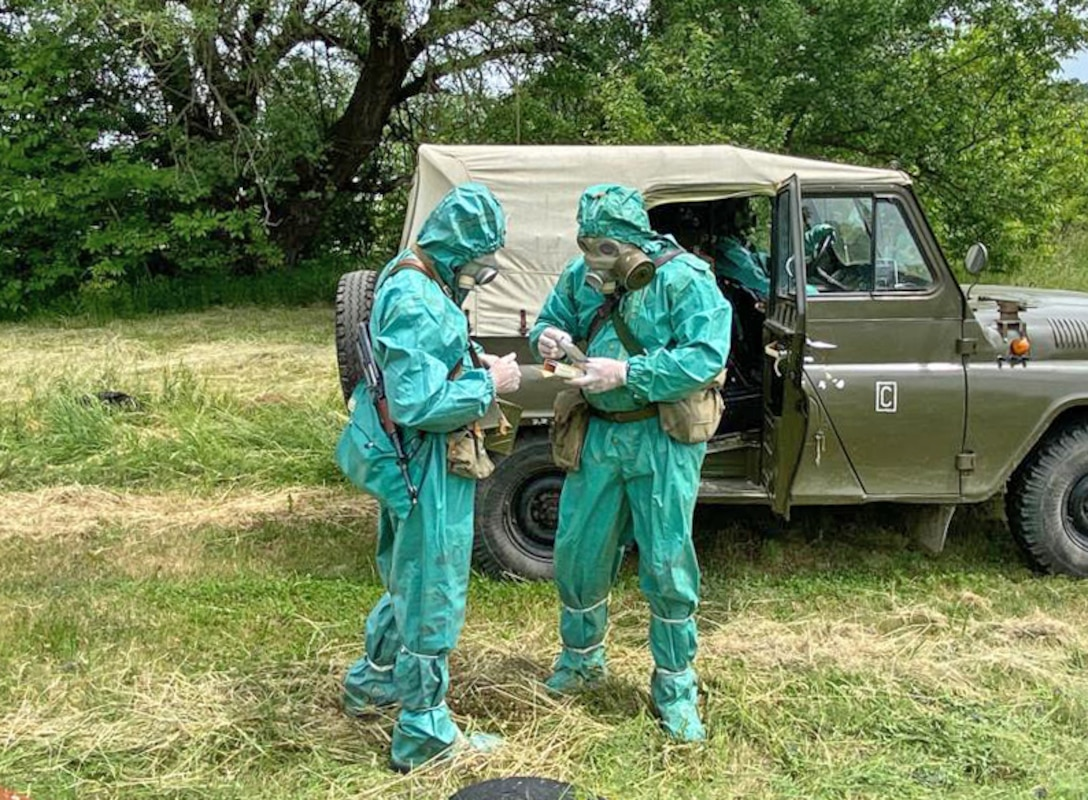 Soldiers from the Bulgarian Army's 38th Chemical, Biological, Radiological, Nuclear Defence Battalion open chemical sampling kits while suited up in protective gear to demonstrate CBRN reaction procedures during a military-to-military exchange held with U.S. Army Reserve Soldiers from the 773rd Civil Support Team, 7th Mission Support Command, in Sofia, Bulgaria, May 25-28, 2021. The event was designed to enhance relationships and interoperability with Allies and partner nations. (U.S. Army Reserve photo by Staff Sgt. Rosannie Murillo, 773rd CST)