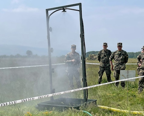 U.S. Army Reserve Lt. Col. Mary J. Durham, commander of the 773rd Civil Support Team, 7th Mission Support Command, left, observes chemical, biological, radiological, nuclear decontamination shower procedures alongside Soldiers from the Bulgarian Army's 38th CBRN Defence Battalion during a military-to-military exchange held in Sofia, Bulgaria, May 25-28, 2021. The event was designed to enhance relationships and interoperability with Allies and partner nations. (U.S. Army Reserve photo by Staff Sgt. Christopher Branning, 773rd CST)