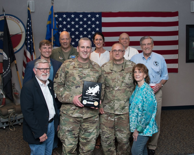 Maj. Gen. Brian Borgen, Tenth Air Force Commander and Chief Master Sgt. Jeremy Malcom, Tenth Air Force Command Chief, present the Power and Vigilance Award to Col. Joseph Marcinek, 655th Intelligence, Surveillance, and Reconnaissance Wing Commander and Chief Master Sgt. Bohdan Pywowarczuk II, 655th ISRW Command Chief.