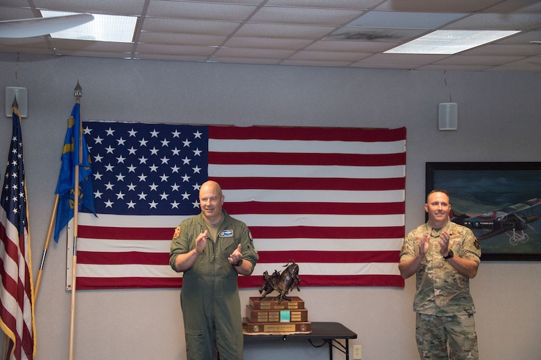 Maj. Gen. Brian Borgen, Tenth Air Force Commander and Chief Master Sgt. Jeremy Malcom, Tenth Air Force Command Chief, announce the winner of the Power and Vigilance Award