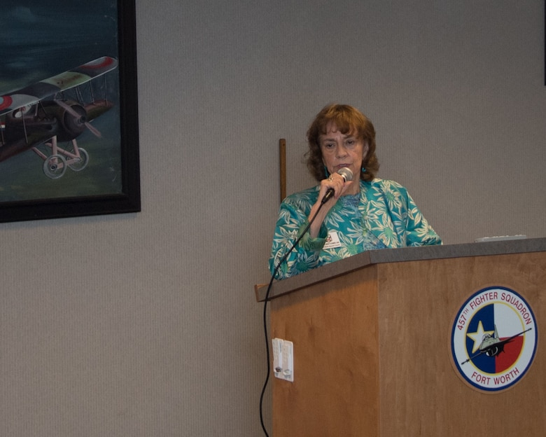 """Ms. Maritta Sumner, Fort Worth Air Power Council Board Chair, speaks about the history of the Tenth Air Force Power and Vigilance Award. The award is presented to the Tenth Air Force unit which best exhibits the Numbered Air Force's vision as """"The premier provider of affordable, integrated, flexible and mission-ready Reserve Citizen Airmen to execute power and vigilance in support of U.S. National Security."""""""