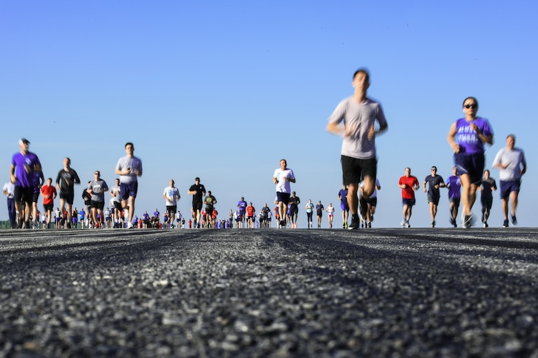 Team McConnell Airmen and family jog during the first annual Run-the-Runway event June 4, 2021, at McConnell Air Force Base, Kansas. Approximately 350 participants ran the morale-boosting event that was hosted by the 22nd Operations Group. (U.S. Air Force photo by Senior Airman Alan Ricker)
