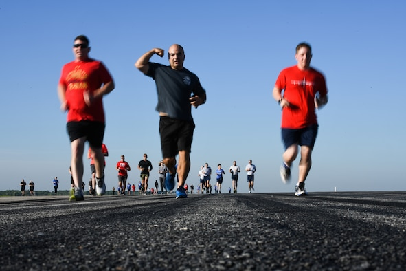 Team McConnell Airmen and family run during the first annual Run-the-Runway event June 4, 2021, at McConnell Air Force Base, Kansas. Awards were presented to the top three women and men that completed the 5k run. (U.S. Air Force photo by Senior Airman Alan Ricker)