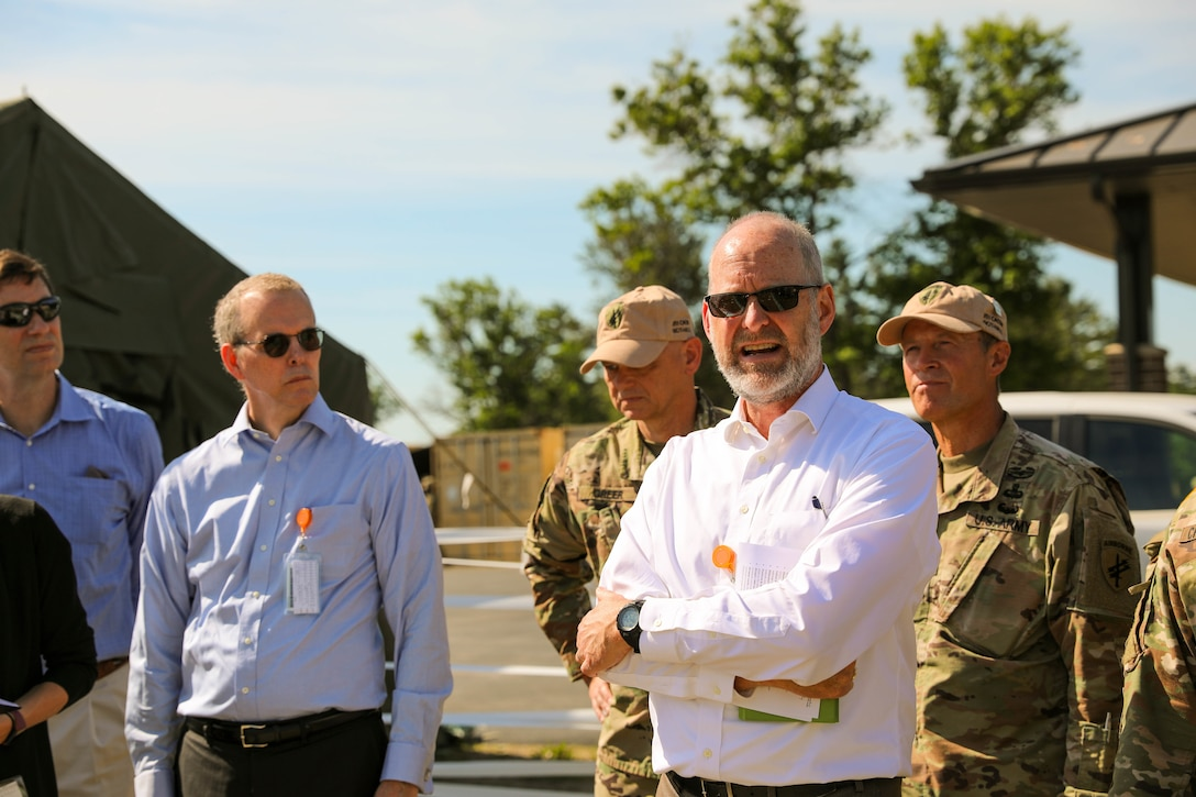 Geoff Odlum (right), an exercise support contractor, briefs as a foreign service officer during the Rehearsal of Concept drill at Command Post Exercise – Functional (CPX-F) 21-02 at Ft. McCoy, Wis., June 5, 2021. As a contracted role player, Odlum adds a layer of detailed coordination and realism to the exercise that troops are seldom able to replicate at home station.