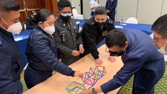 Students build bridge on table.