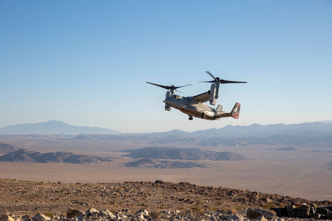 """A U.S. Marine Corps MV-22B Osprey with Marine Medium Tiltrotor Squadron 163, Marine Aircraft Group 16, 3rd Marine Aircraft Wing (MAW), prepares to land during exercise Titanium Wrath at Outpost Creole aboard Marine Corps Air Ground Combat Center Twentynine Palms, California, May 26, 2021. As America's """"Force in Readiness,"""" Marines must remain ready when others are not. 3d MAW's combat power includes hundreds of combat ready aircraft each operated and maintained by thousands of professional warriors who can think critically and act decisively. (U.S. Marine Corps photo by Lance Cpl. Juan Anaya)"""