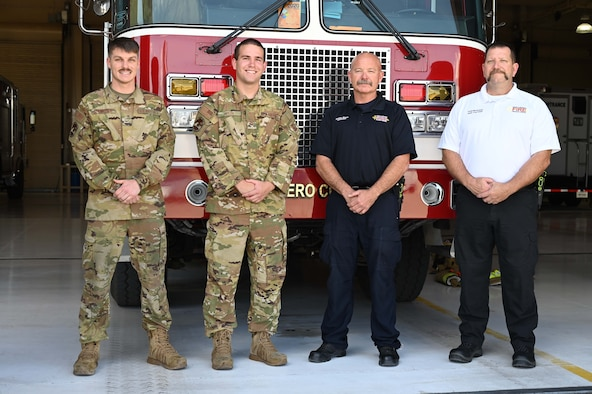 (From left to right) Airman 1st Class Joshua Hennigan, 49th Civil Engineer Squadron firefighter;  Senior Airman Cameron Nolen, 49th CES driver operator; Norman Bloom, 49th CES lead firefighter; and Todd McGowan, 49th CES assistant fire chief, pose for a photo on Holloman Air Force Base New Mexico, June 1, 2021. Hennigan, Nolen, Bloom and McGowan were on the team of first responders that helped deliver the Novotnak's daughter. (U.S. Air Force Photo by Denise Ottaviano)