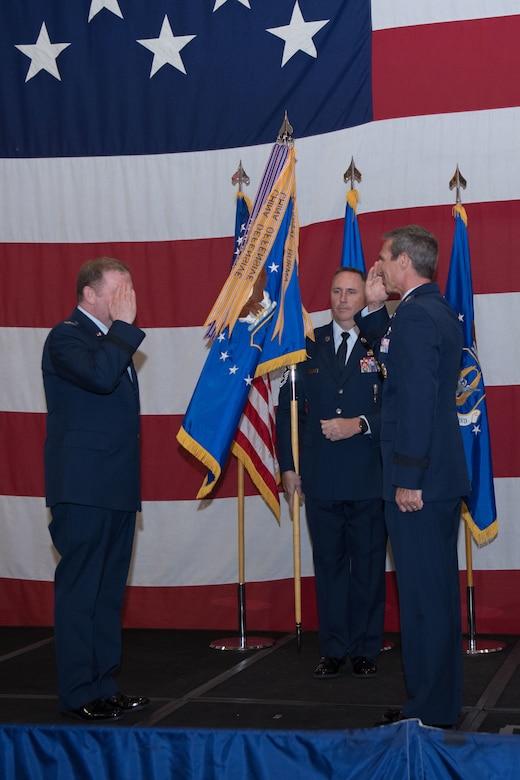Maj. Gen. Radliff renders a salute to Lt. Gen. Richard Scobee to finalize the assumption of command.