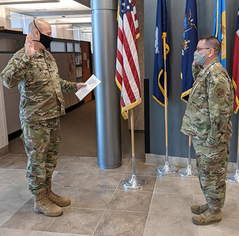 Armitage reenlists in New York ANG