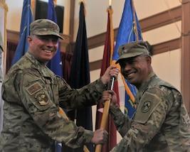 U.S. Army Brig. Gen. Lance A. Okamura and U.S. Navy Rear. Adm. Timothy C. Kuehhas pose for a photo.