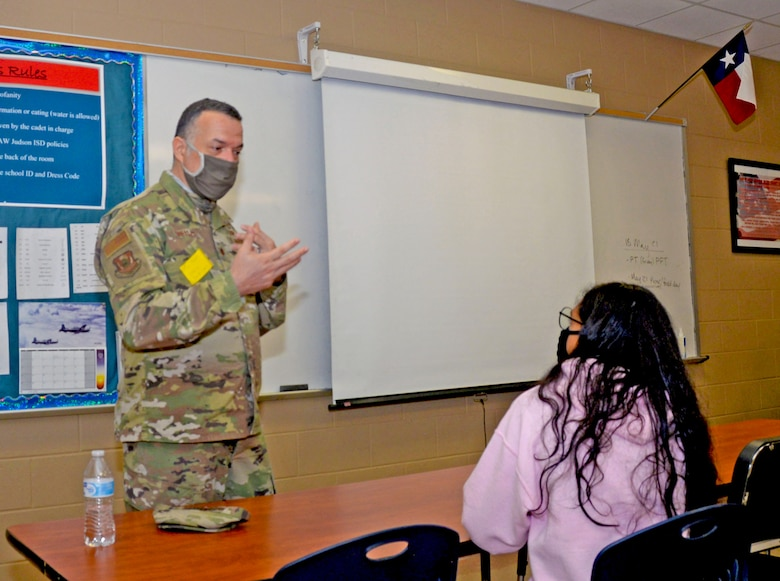 Maj. Eduardo Trelles, 960th Cyberspace Wing intelligence planning branch chief, speaks to a Junior Reserve Officer Training Corps student about becoming a foreign affairs officer at Judson High School, Converse, Texas, May 19, 2021. (U.S. Air Force photo by Samantha Mathison)