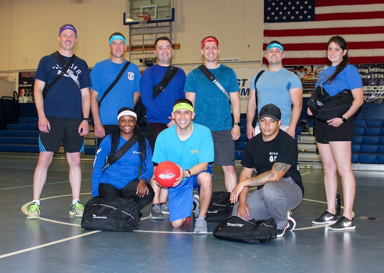 Members of the 379th Space Range Squadron gather at the Schriever Fitness Center after winning a dodgeball tournament hosted by the Schriever Sexual Assault Response and Prevention team on May 27, 2021, at Schriever Air Force Base, Colorado. The SAPR office held the event to raise awareness for the SAPR program. For additional information regarding the SAPR program and resources available, including methods of reporting, local and national assistance phone number and unit classes available by request, visit www.schriever.spaceforce.mil/SAPR. (U.S. Space Force photo by Marcus Hill)