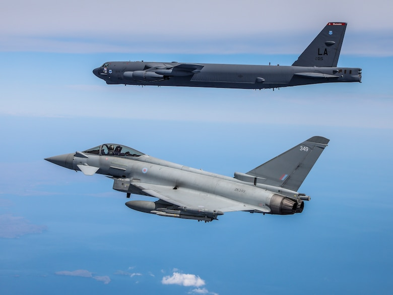 A B-52H Stratofortress operating out of Morón Air Base, Spain, flies alongside a Royal Air Force Eurofighter Typhoon during the Bomber Task Force Europe mission Allied Sky, May 31, 2021. Forward locations in Europe enable the U.S. Air Force to live, train, and fight with allies and partners. (Courtesy photo by the Royal Air Force)