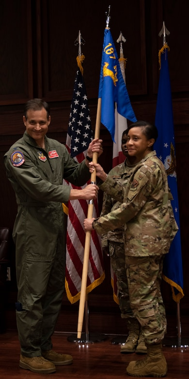Col. McKennie relinquishes command of the 187th Medical Group during a change of command ceremony.