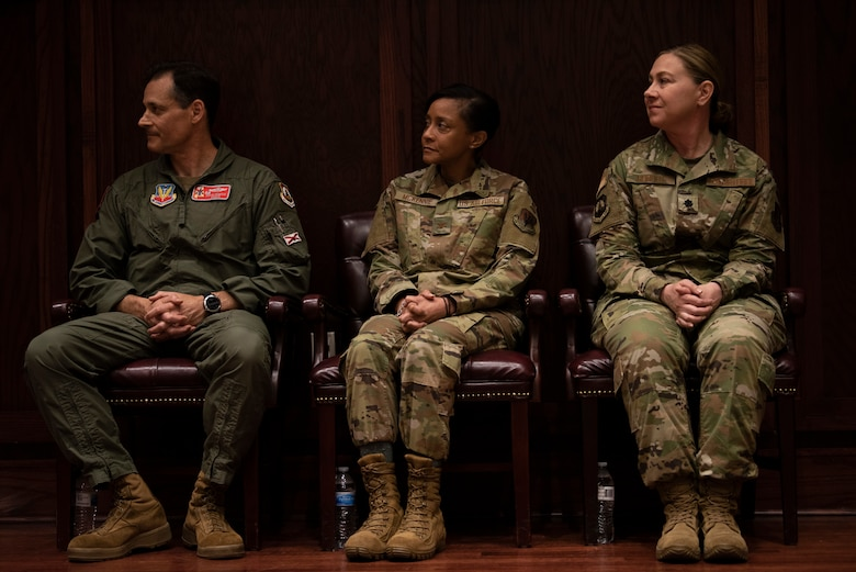 Col. DeMaio, Col. McKennie, and Lt. Col. Mundell sit during a medical group change of command ceremony.