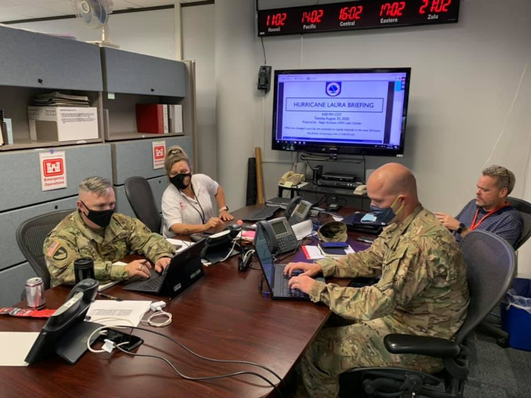 SWG District Commander Tim Vail (left) gets a briefing from  members of the District's Emergency Management team prior to Hurricane Laura in 2020. The SWG Team is prepping for what is expected to be an active 2021 Hurricane Season.