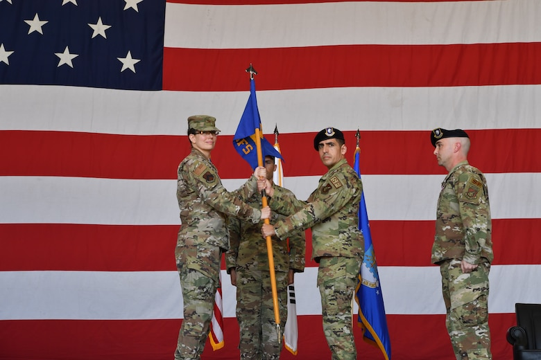 Commanders pose for a photo during a ceremony.