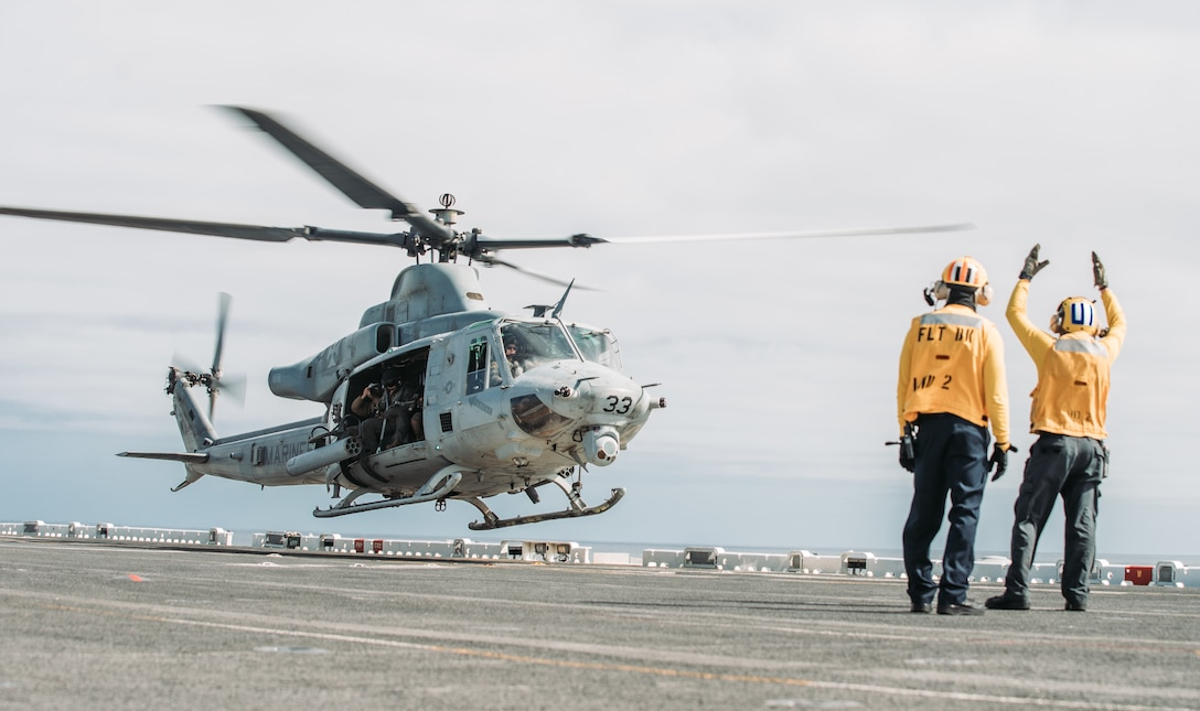 U.S. Sailors signal a UH-1Y Venom during takeoff from Essex, May 13.