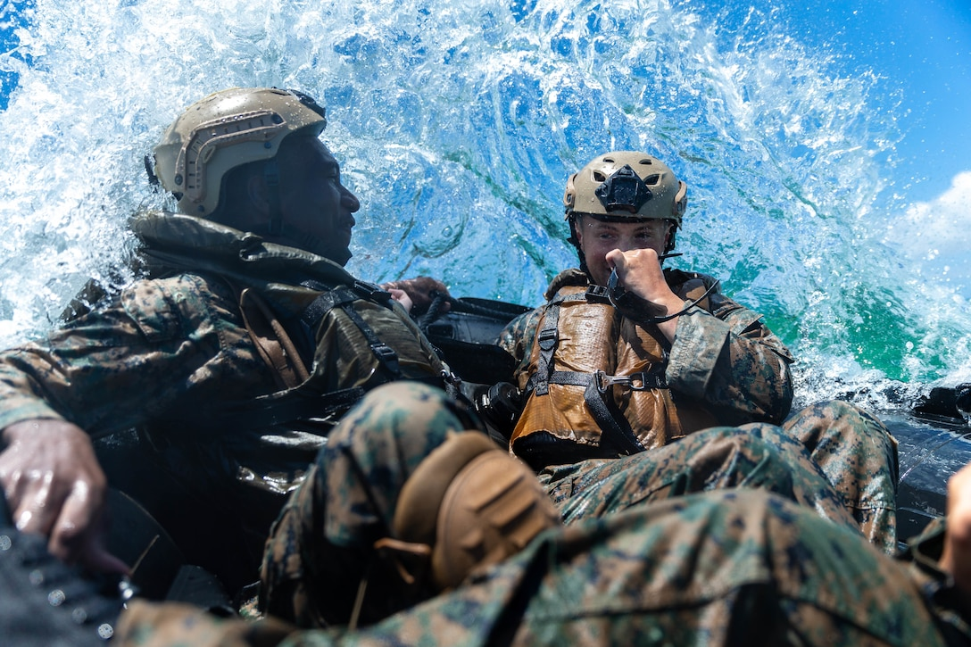 U.S. Marines with India Company, Battalion Landing Team, 3rd Battalion, 5th Marines, 31st Marine Expeditionary Unit, take on crashing waves while riding in the front of a Combat Rubber Raiding Craft during an amphibious raid rehearsal at Kin Blue training area, Okinawa, Japan, May 14, 2021. Marines with the 31st MEU conduct raid rehearsals in order to test operational equipment, sustain proficiency in small boat handling fundamentals and refine standard operating procedures. The 31st MEU, the Marine Corps' only continuously forward-deployed MEU, provides a flexible and lethal force ready to perform a wide range of military operations as the premier crisis response force in the Indo-Pacific region.
