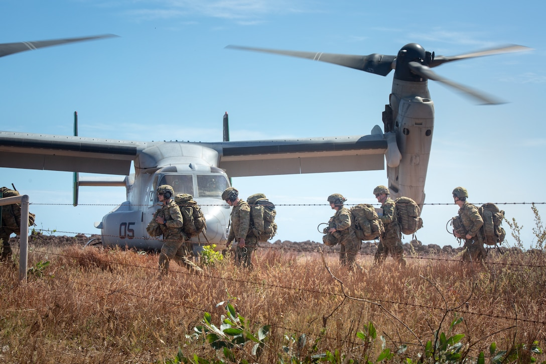 Australian Army soldiers carry their gear off a landing zone at Point Fawcett, Australia, May 24.