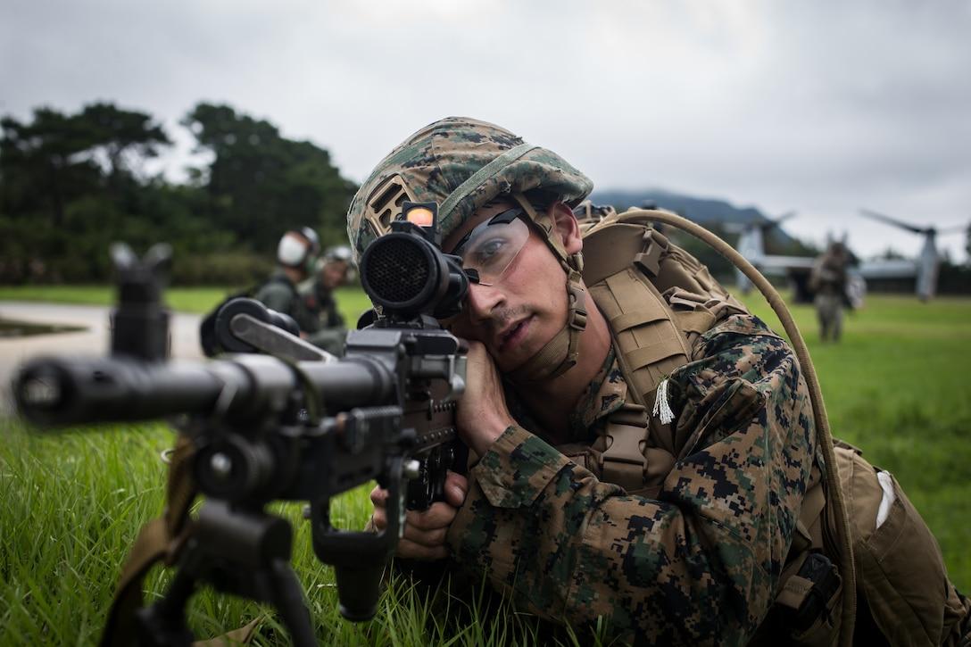 A U.S. Marine posts security on Camp Hansen, Japan, May 25.