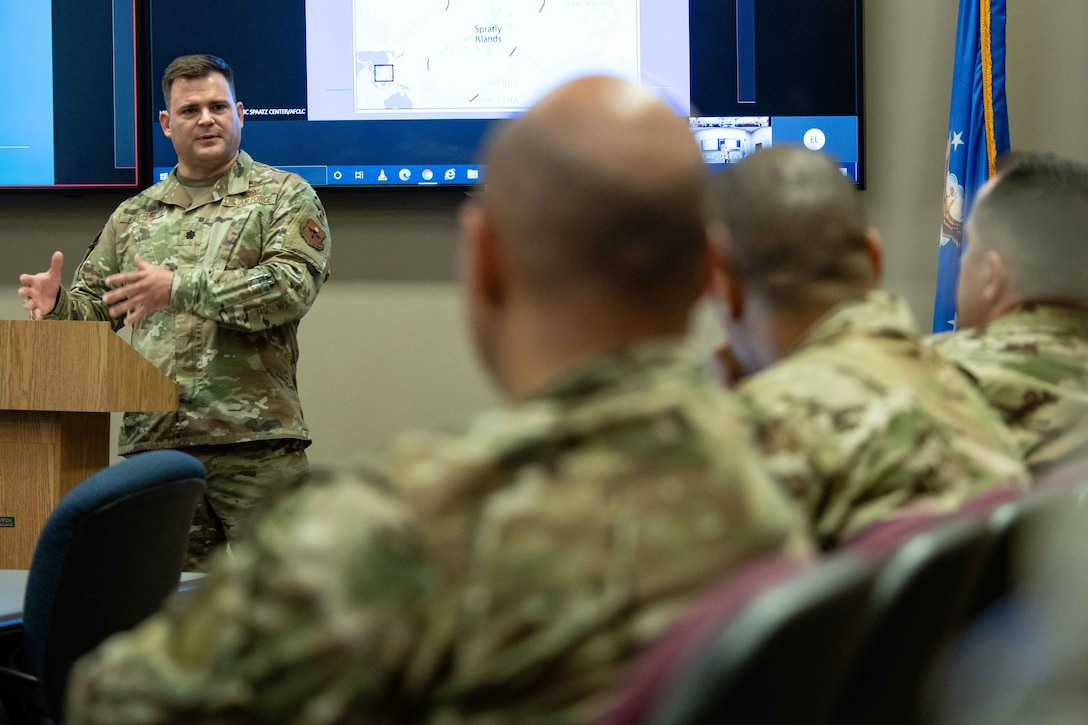 Lieutenant Col. Justin Settles, deputy director, China Aerospace Studies Institute, presents a lecture at the China 'Belt and Road Initiative' training event June 8, 2021, at the Air University Teaching and Learning Center, Maxwell Air Force Base, Alabama.