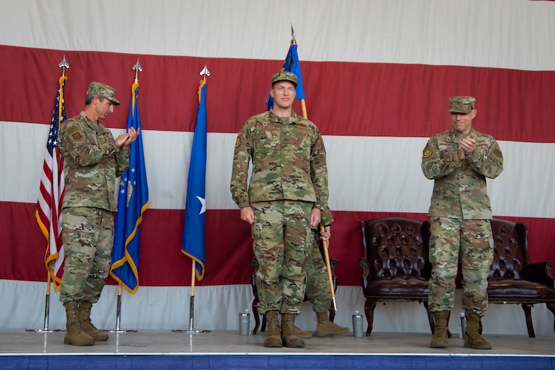Maj. Gen. Bryan Radliff, 10th Air Force Commander and Col. Jim Greenwald, outgoing 944th Fighter Wing Commander, applaud Col. Mark Van Brunt, incoming 944th Fighter Wing Commander during the 944th FW change of command ceremony at Luke Air Force Base, Ariz., June 6, 2021. Friends, family, community members, members of the Archer-Ragsdale Arizona Chapter of Tuskegee airmen, and men and women of the 944th and 56th Fighter Wings attended the morning ceremony, presided over by Radliff.