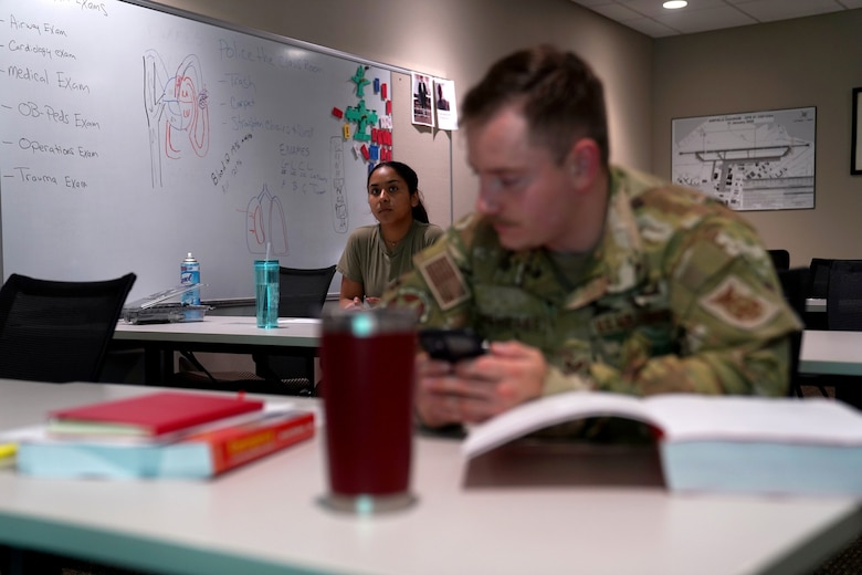 U.S. Air Force Airman 1st Class Cinthia Juarez, 81st Civil Engineer Squadron driver operator, and Airman 1st Class Kyle Cremeans, 81st CES crew chief, prepare for class inside the fire station at Keesler Air Force Base, Mississippi, June 2, 2021. The Keesler Fire Department responds to medical emergencies on and around base 24 hours a day. (U.S. Air Force photo by Senior Airman Seth Haddix)