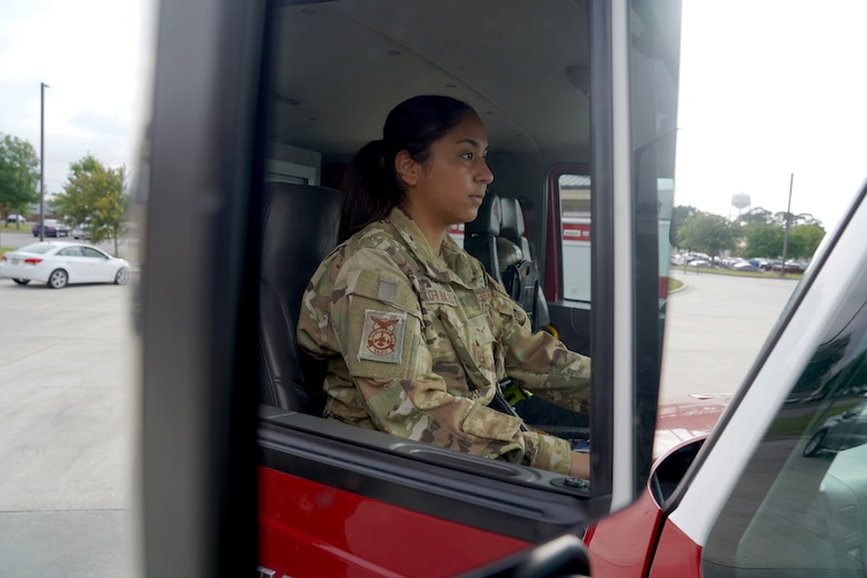 U.S. Air Force Airman 1st Class Cinthia Juarez, 81st Civil Engineer Squadron driver operator, operates a fire truck outside the fire station at Keesler Air Force Base, Mississippi, June 2, 2021. The Keesler Fire Department responds to medical emergencies on and around base 24 hours a day. (U.S. Air Force photo by Senior Airman Seth Haddix)