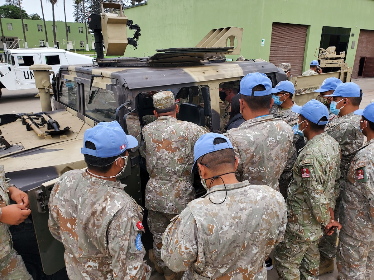 Members of the West Virginia National Guard train Peruvian Armed Forces on the M1165 High Mobility Multipurpose Wheeled Vehicle as part of the National Guard's State Partnership Program in Lima, Peru, June 3, 2021. Peru will use the training on an international peacekeeping mission in the Central African Republic.