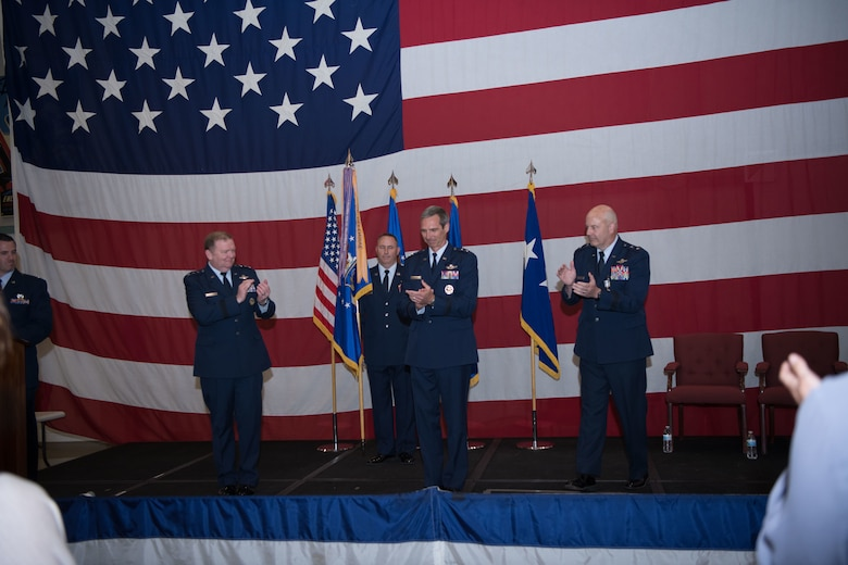 Maj Gen Bryan Radliff receives a round of applause after accepting command of Tenth Air Force.