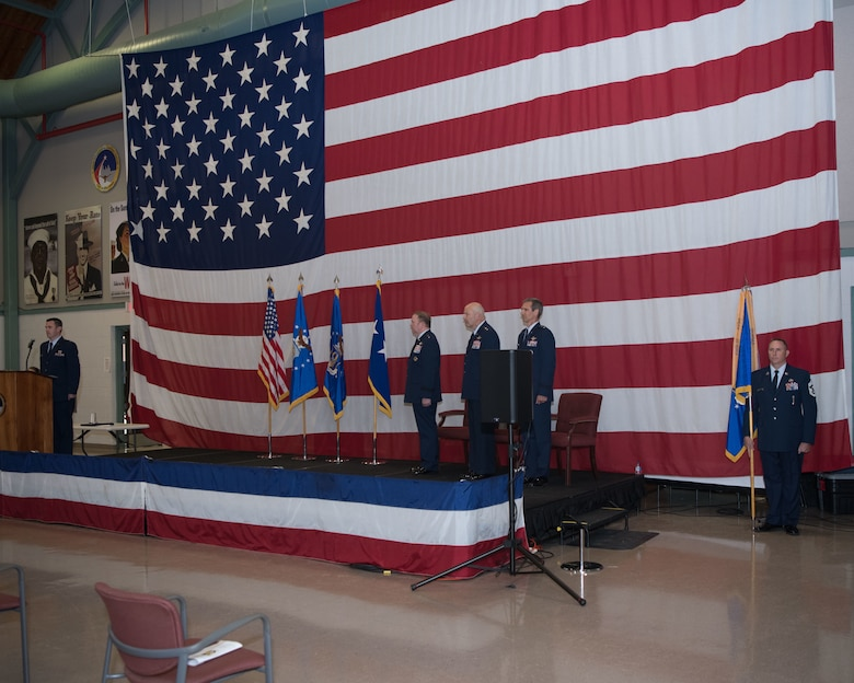 Lt. Gen. Richard Scobee, Chief of the Air Force Reserve and Commander Air Force Reserve Command, Maj. Gen. Brian Borgen, Commander Tenth Air Force (outgoing) and Maj. Gen. Bryan Radliff, Commander Tenth Air Force (incoming), stand at attention as the Dyess Honor Guard exits after presenting the colors.