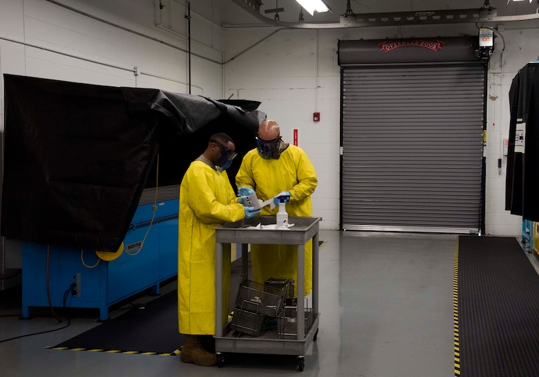 Maintainers with the 6th Maintenance Squadron nondestructive inspections (NDI) unit clean an aircraft part at MacDill Air Force Base, Florida, June 4, 2021.