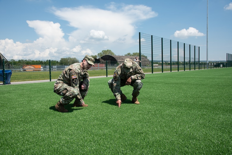 USACE Europe District commander Col. Patrick Dagon and Col. Mario A. Washington, Garrison Commander, U.S. Army Garrison (USAG) Wiesbaden inspect the new artificial turf field located at Clay North.