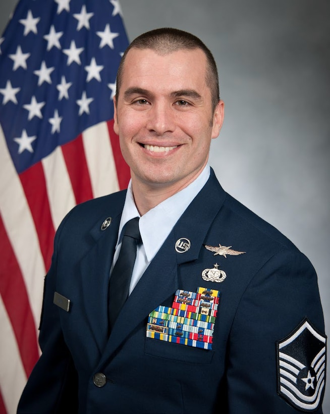 Master Sgt. Michelangelo Serio, 689th Network Operations Squadron defensive cyber operations section chief, has an official photograph taken at Maxwell-Gunter Air Force Base, Alabama, May 11, 2019. (U.S. Air Force courtesy photo)