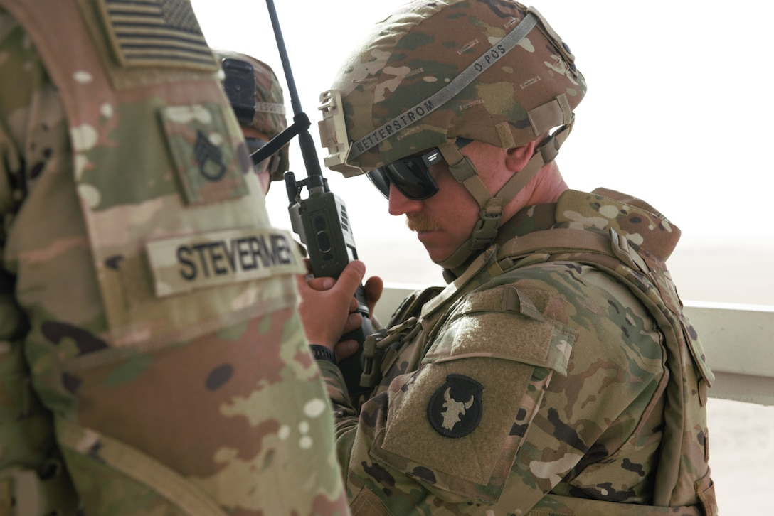 A photo of a Soldier using a radio
