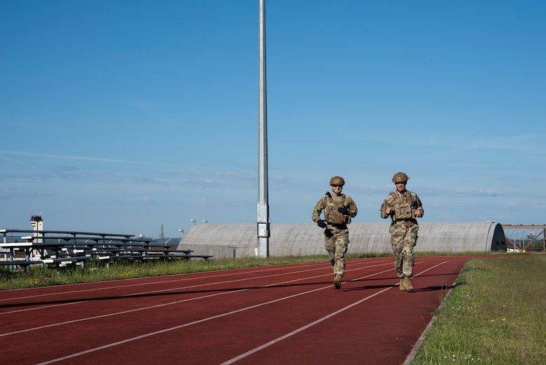 U.S. Air Force Lt. Col. Ben Washburn, 52nd Security Forces Squadron commander (right), and 2nd  Lt. Nicolas Niazian participate in the Defender Challenge at Spangdahlem Air Base, Germany, June 2, 2021.